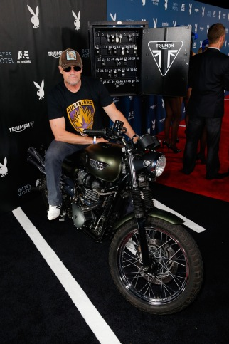SAN DIEGO, CA - JULY 25:  Actor Michael Rooker attempts to start the engine for charity of the Triumph Scrambler Custom on display at the Playboy and A&E Bates Motel Event During Comic-Con Weekend, on July 25, 2014 in San Diego, California.  (Photo by Joe Scarnici/Getty Images for Playboy)