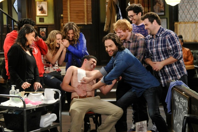 "UNDATEABLE -- ""A Live Show Walks Into A Bar"" Episode 209 -- Pictured: (l-r) Ron Funches as Shelly, Bridgit Mendler as Candace, Bianca Kajlich as Leslie, Brent Morin as Justin, Chris D'Elia as Danny, Ed Sheeran as himself, Rick Glassman as Burski, David Fynn as Brett -- (Photo by: Darren Michaels/NBC/Warner Bros.)"