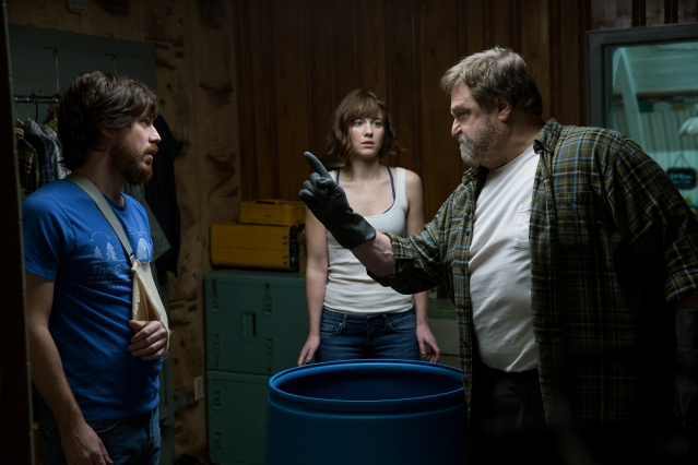John Goodman as Howard, Mary Elizabeth Winstead as Michelle, and John Gallagher Jr. as Emmett in 10 CLOVERFIELD LANE, by Paramount Pictures