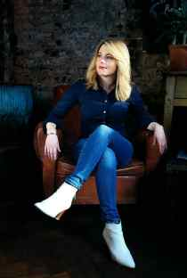 the-Five-portrait-leather-chair-blue-blouse